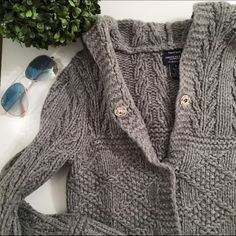Chunky gray sweater Hand knit chunky gray sweater • 100% lambs wool• open with 3 snaps to close • hood in the back• perfect condition and super cozy & comfy, perfect sweater to cuddle up in American Eagle Outfitters Sweaters