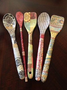 #DIY #Craft #Spoons First, I bought big chunky wooden spoons at Walmart. Then I picked out some scrapbooking paper I liked that would match my house. I decoupaged the paper into different designs onto the spoons. When it was all done, I put a few more layers of #decoupage on the decorated spoon to make sure it was indestructible. And this is how it turned out. I love them!