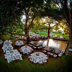 lights from trees, outdoor reception and different tables ... dream reception