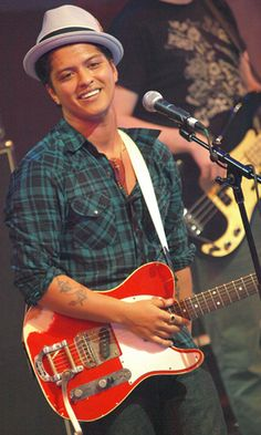 I love Bruno Mars . I'm listening to free music Of Bruno Mars now at http://stationdigital.com/?ref=ref1 streaming radio. Check it out !