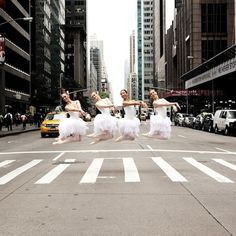 ballerinas in city streets by lisa tomasetti