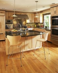 New Gray Countertops with Brown Cabinets