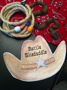 Cowboy theme party games - Rattle Skedaddle... played where they just tried to toss the ring around the snake.