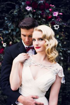 Black & Gold NYE Wedding: beautiful bride and groom, giant floral wreath by Celsia Floral.