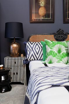 love that mix of prints! PAD Adore Aug/Sept 2012, black, green, caned headboard, tropical, pineapple, gold
