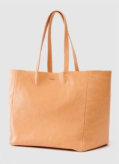 baggu have added to their range with some new products, including this large leather tote. i'm a big fan of their ripstop nylon reuseable bags, and i think the same simple styling works really well in leather. the leather bags i posted about last year are as simple as they get, but this tote has a few extra features. details include dual riveted handles and an interior zip pocket, and it measures 14″ x 12″ x 7″ with a 10″ handle drop. made in nyc, and available from baggu for $240.