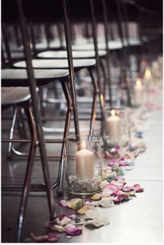Candles and petals on wedding aisle