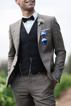 groom grey and black suit | Image by Christophe Serrano