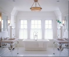 So clean and bright.  I like the built in cabinets on either side of the tub.
