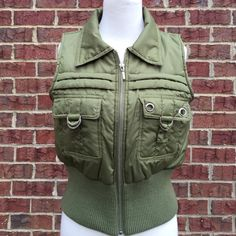 Sleeveless Jacket Misses large, sleeveless jacket with front zipper and two front buckle pockets. Great seasonal jacket, wear alone or with sweater or top. Jackets & Coats Puffers