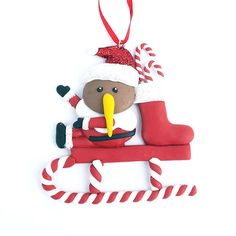 This Clay Santa Kiwi on a Sleigh Xmas Ornament will look so cute your Christmas tree. Kiwi Bird, Kiwiana, Santa Sleigh, Xmas Ornaments, Santa Hat, Xmas Tree, Christmas Stockings, Snoopy, Clay