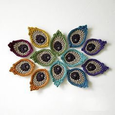 This is a photo tutorial with written instructions for my original Peacock Eye Feather Appliques or Motifs.