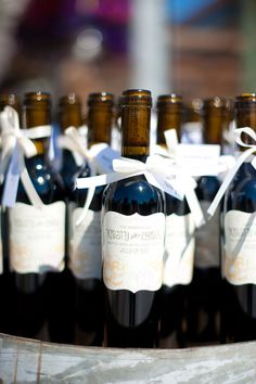 Personalized wine labels with bows.