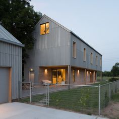 Cement-fibre panels that appear to have the same texture as an elephant's skin clad the exterior of this home that Sean Guess built for himself in Austin.
