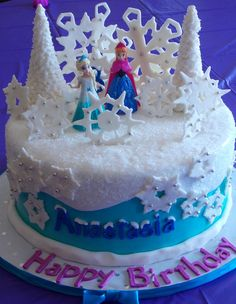 Disney Frozen Cake. Anna and Elsa dolls provided by client. French Vanilla Cake with Vanilla Cream Filling iced in Swiss Meringue Buttercre...