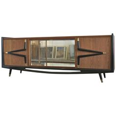 Sculptural Eugenio Escudero Credenza or Sideboard | From a unique collection of antique and modern buffets at https://www.1stdibs.com/furniture/storage-case-pieces/buffets/