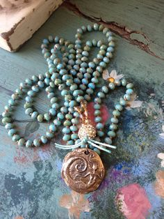 These beads are so filled with color, sparkle and shine.....and the handmade bronze mermaid is meant to be paired with them. All colors of the