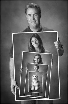 portrait inside portrait dad, mom, kid, dogs...everyone wearing santa hats?