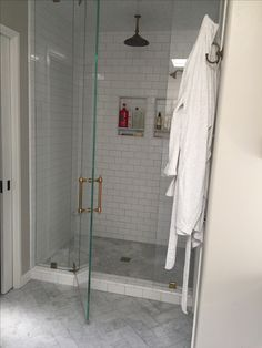 Gorgeous carrara marble and subway tile bathroom with gold accents.