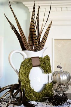 My November Mantel {How to Decorate a Mantel series}, pheasant feathers in cream pitcher, mossy C letter, antlers