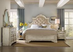 The romantic side of chic farmhouse style is shown in this Sanctuary panel bed from Hooker Furniture.