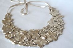 Gold leather flower statement necklace by Cristina Costache