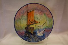 """Catalina Island Pottery cold painted plate - Sailing ship with 1 sail and seagulls, rear view, 12-1/2"""". Painted by Graham."""