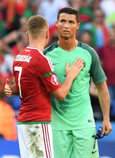 #EURO2016 Portugal's forward Cristiano Ronaldo embraces Hungary's midfielder Balazs Dzsudzsak at the end of the Euro 2016 group F football match between...