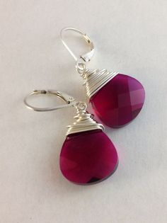 Radiant orchid teardrop earrings. Sterling silver wire wrapped jewelry. Ruby Swarvoski crystal briolettes. Handmade earrings.