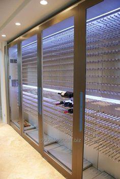Винный шкаф, винный погреб в частном доме, профессиональное хранение вина