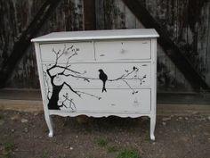 Bird in a tree dresser