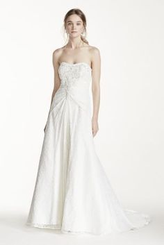 You will look breathtaking in this timeless and chic wedding dress!  Strapless all over lace bodice with intricate beaded detail, ultra-feminine sweetheart neckline lined with beads.  Classic A-line silhouette is romantic and traditional.  Chapel train. Available in Ivory online only.  Women:Style 9OP1240. Sizes 16W-26W. $849.  Fully lined. Back zip. Imported. Dry clean only. To preserve your wedding dreams, try our Wedding Gown Preservation Kit.