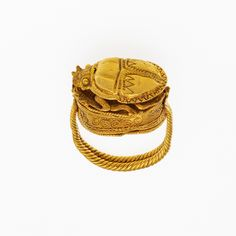 This is a truly fascinating piece made out of gold. It is a gold box ring that has a gold scarab on top of it. It was first seen in 330 to 310 B.C and its creator is unknown it is currently owned by the Metropolitan Museum of Art
