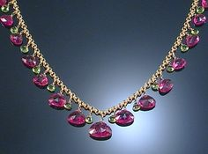 TOURMALINE NECKLACE.  Designed as a fringe of graduated triangular-shaped rubellite drops interspersed with similarly-shaped green tourmaline highlights, length approximately  430mm.