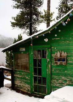 Love the green finish on this wonderful cabin.