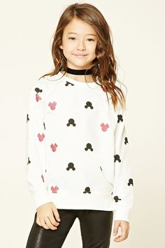 $17.90 A knit sweatshirt featuring an allover Mickey Mouse and shimmering Minnie Mouse print, French terry cloth lining, ribbed trim, a round neckline, and long sleeves.