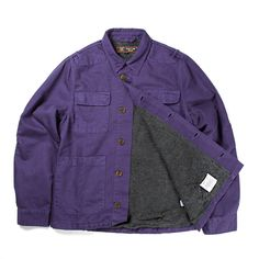 The needle jacket is a short fitting chore jacket made from purple overdyed herringbone cotton, lined for extra warmth. Barbour equipped the jacket with plenty of dept. (B) touches such as triple stitched seams and reinforced elbows.