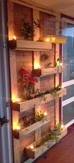 Pallet planters are not that difficult to build. Place vertical beams of pallet on the brick wall for support then fix four by one pallet cases or pallet planter on them. Use lights to decorate them and also hang cages to make the look complete Outdoor Projects, Home Projects, Craft Projects, Palette Diy, Outdoor Lighting, Outdoor Decor, Lighting Ideas, Balcony Lighting, Fence Lighting