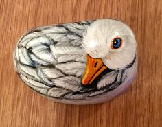 image of a duck painted on stone...