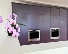 #Aubergine #kitchen #design with double #ovens and pink #orchid. Love it!