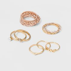 Enhance your ring game with this elegant 10pc ring set! The mixed metals and simulated pearl details are trending. Mix and match for various combinations to enhance your style!