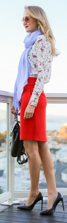 silk floral blouse, bright red angled pencil skirt, periwinkle blue silk scarf + black leather backpack and pumps