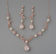 DK651: Cubic Zirconia and Swarovski Pearl necklace is available in 16 inches (40.5cm), 18 inches (45.5cm) and 20 inches (51cm) long and it has an extension 2 inches (5cm) long. Please select the size that you need. Earrings are about 2.5 inches (6.1cm) long.  Materials and sizes: Swarovski pearls are made in Austria. Pearls size: 6mm Pearl color: cream Necklace Zircon drop is 18mm high and 16mm wide Earrings Zircon are 16mm high and 11mm wide Round Zircons: 9mm and 6mm Leaves: 23mm long and…