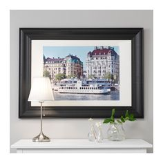 Cover those walls! Art and photographs of family or places make a house a home. Once again, they increase the out-of-a-magazine factor. And if you don't have any great shots, head online and print some high quality images. SKATTEBY Frame  - IKEA
