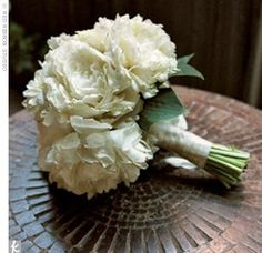 The ceremony chairs were decorated with clusters of green hydrangeas the ceremony chairs were decorated with clusters of green hydrangeas purple lisianthus and cream roses flowers pinterest cream roses mightylinksfo