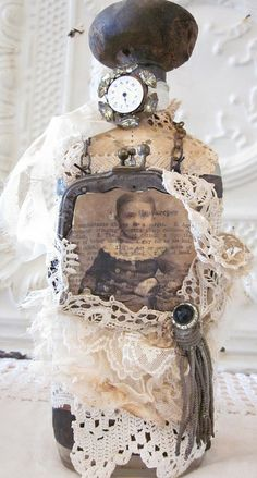 time keeper bottle by tarnished and tattered, via Flickr  love the vintage dress form look
