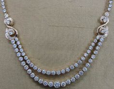 Classic diamond necklace – Classic necklace of twin rows of solitaire diamonds is handcrafted in 18 kt YG.