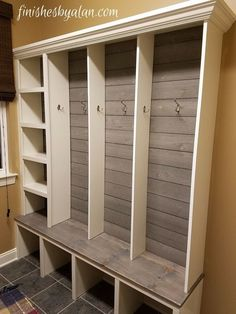 Beautiful, modern mudroom bench with grey shiplap, dividers and brushed nickel hardware.