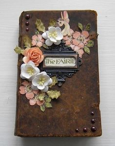fairy journal embellished with story book cutouts and white and coral flowers, orange, peach