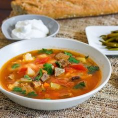 Best kept Romanian secret, the delicious beef soup, very sour and seasoned with lovage.